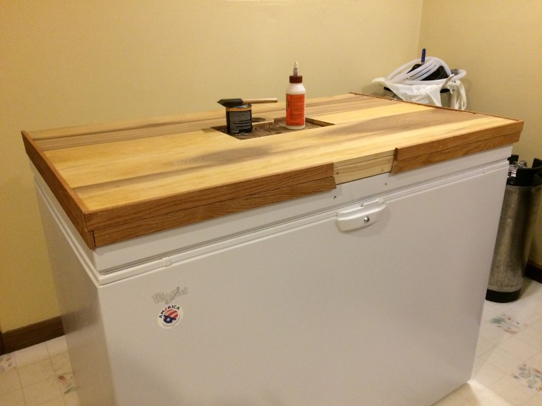 """Red oak trim attached, and just waiting for the second coat of stain to dry. I used the lightest """"natural"""" stain I could find; hopefully the natural colors of the woods dominate. So far so good anyway."""